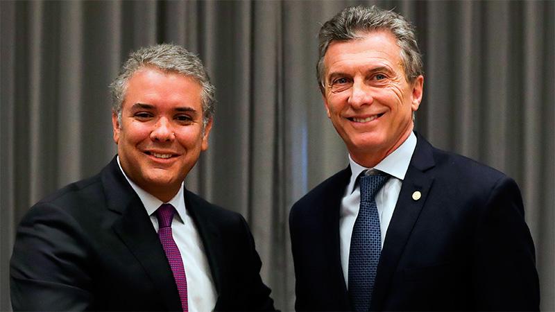 Iván Luque junto a Macri