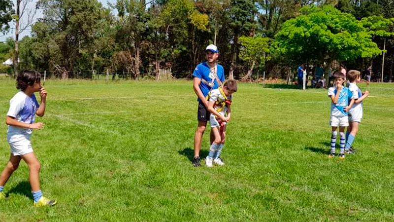 Felipe y su profesor de Rugby.