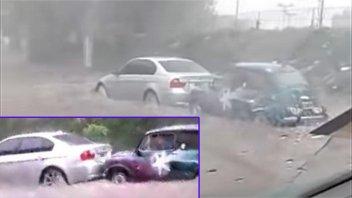 Videos: El Fitito rescató a un BMW durante la inundación en Buenos Aires